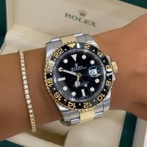 Discontinued Rolex GMT MASTER II - złoto, stal i czarny cyferblat